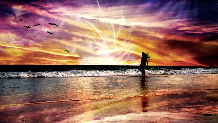 Donna con anima passeggia in riva al mare durante una alba colorata